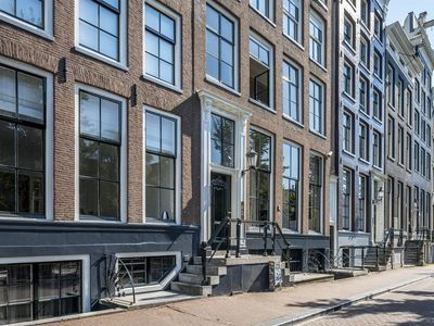 Photo for Super 17th century canal house apartment with amazing view in Amsterdam
