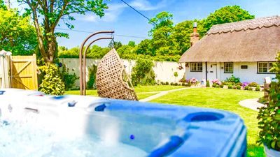 Cottage, hot tub and swing chair all for your relaxation