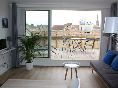 Photo for Beautiful apartment overlooking the rooftops of Bordeaux
