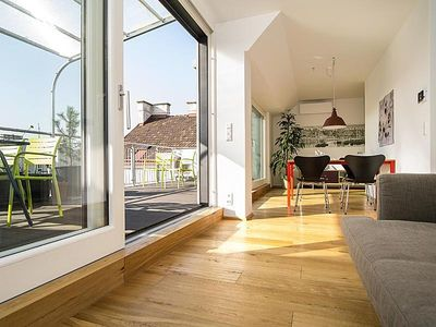 Photo for Sunny attic apartment with large terrace