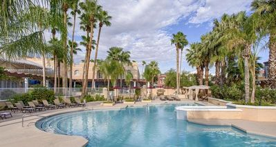 Large heated swimming pool, poolside loungers and picnic tables