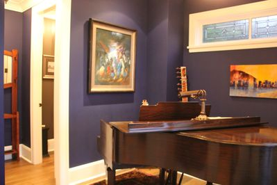 Entrance way with Grand Piano, foyer and powder room
