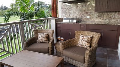 Convenient outdoor BBQ and cozy lanai furniture