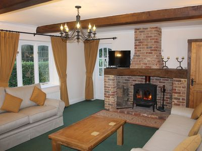 Photo for Yaffle Cottage. Home comfort in an idyllic woodland location