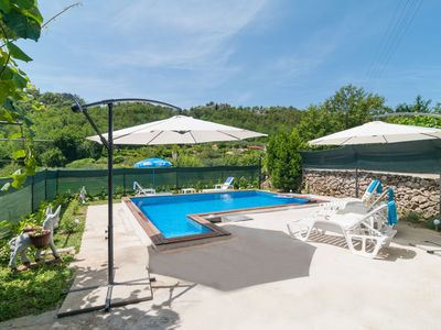Photo for This 3-bedroom villa for up to 8 guests is located in Omis and has a private swimming pool, air-cond