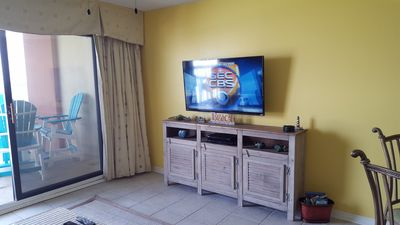 """Living area with 50"""" HD Smart TV."""