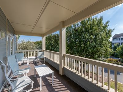 Photo for Walk to the beach! Condo near the bay w/ private balcony & shared pool access!