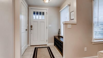 Entry way, coat closet, and shoe cubby