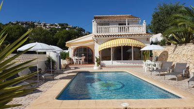 Photo for Villa Ra - Enchanting Moraira Villa with Secluded Pool and Sea View