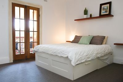 Stylish bedroom with balcony over looking Cooks Hill