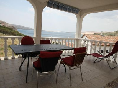 Photo for Two bedroom apartment with terrace and sea view Metajna (Pag)