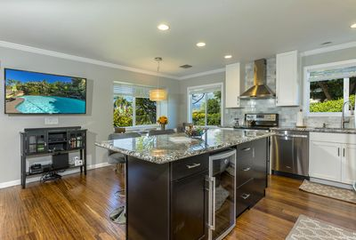Granite island with bar seats and open concept