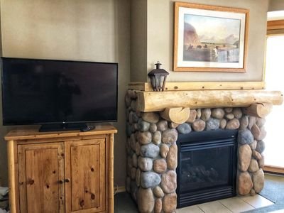 New TV next to gas fireplace