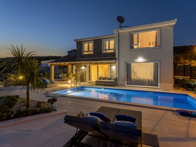 Photo for HILLSIDE villa with sea view and heated pool