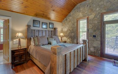 The massive king-size bed in the open cottage style cabin