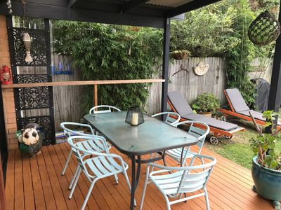 Outdoor dining on covered deck, bbq