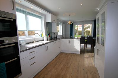 Kitchen incl. fridge, dishwasher, double electric oven, microwave, electric hob.