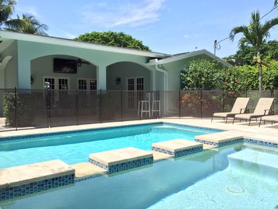 Watch TV from the pool & spa!  The pool safety fence can be removed upon request