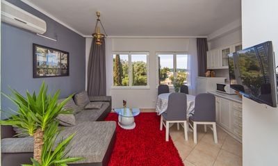 Photo for Sea view apartment in bay of Tiha  with orange shadow garden