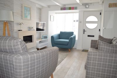 Lounge with large bay window, open fire, freeview smart TV and DAB radio