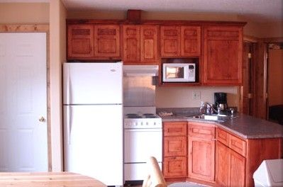 Full Kitchen with Microwave and Coffee Maker.