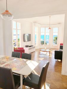 The light filled living/dining area, with views over the Croisette to the sea.