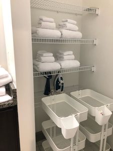 White towels, iron, steamer, individual carts for toiletries!