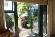 Winstone Cottage - charming large lakeside bach