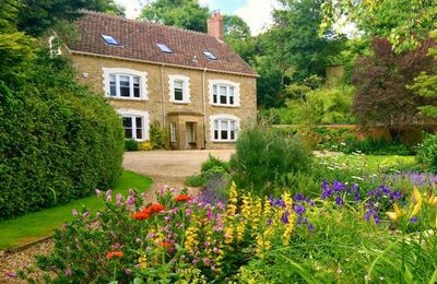 Photo for Puckhams sits  in its own beautiful mature gardens to the front and rear with fine peaceful views.