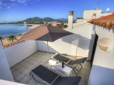 Photo for Sunny Beach apartment in Porto Alcudia Mallorca. This is right on the beach and is for 4 people.