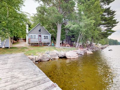 Photo for Rustic, lakefront cabin w/ deck, pebble beach, & outdoor firepit - dogs welcome!