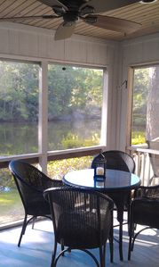 Lounge on the screened porch overlooking the lagoon
