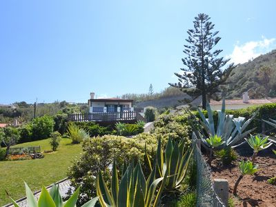 Photo for Beachfront villa for 12, w/ swimming pool and amazing sea views!