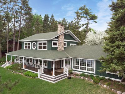 Photo for Spacious Whitefish Lake Retreat with Guesthouse, Dock, and Tennis Court!