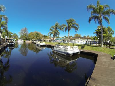 19' pontoon boat waits your arrival!