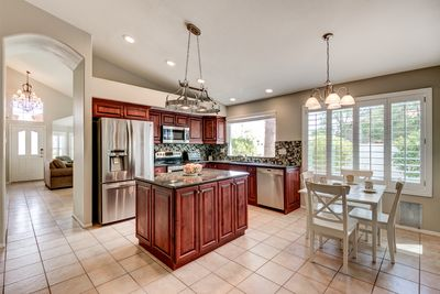 Enjoy a morning cup of coffee in the breakfast nook of your updated kitchen.