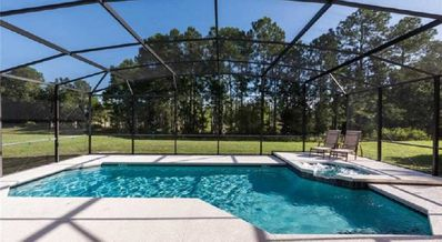 Photo for #469 Fabulous large 6 bed home extended deck,private pool spa conservation view