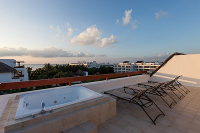 Roof-top terrace with ocean views, jacuzzi and loungers