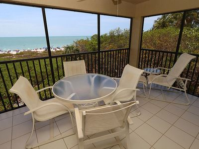 Photo for Two Bedroom Beachfront Corner Condo on Sanibel's West Gulf Drive - Tarpon Beach 309