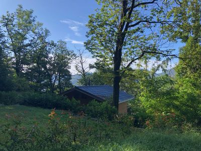 Photo for Newly built cozy chalet with beautiful treetop views of Lake Maggiore