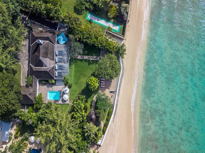 Photo for Tropical Beachfront Oasis with Pool - High Trees
