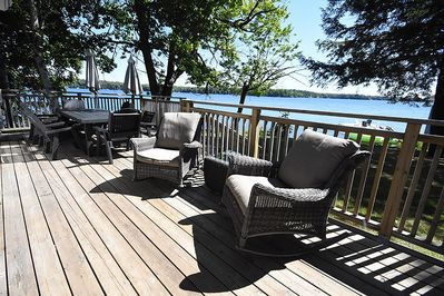 Main deck with outdoor dining and lounge chairs