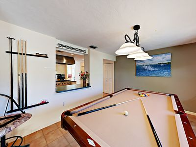 Game Room - Enjoy a night of laughs in the game room with a gorgeous wooden regulation-size pool table.
