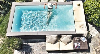 Photo for Modern holiday apartment in a historic house with pool and large terrace