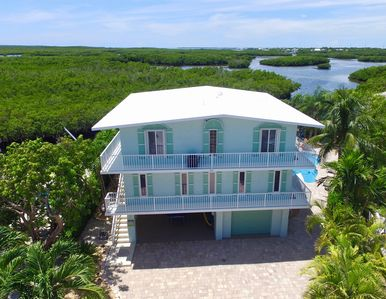 Photo for Breathtaking Paradise! Luxurious Waterfront 3-Story Family Vacation Home w/ Pool