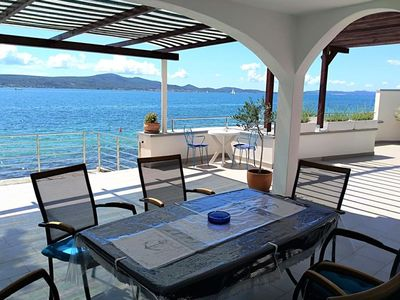 Photo for Amazing two storey holiday home with 120m roofed terrace, directly on the beach!