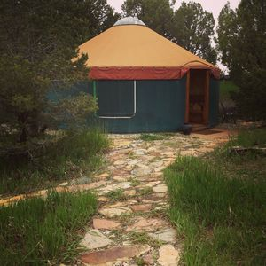 The pathway to the yurt. Recent rains mean green grass! (Guest photo.)