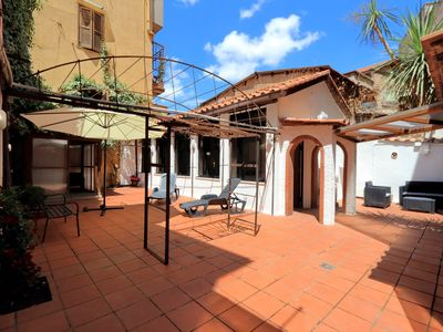 Photo for Charming loft, just renewed, with beautiful garden, Trastevere. Air cond. WIFI.