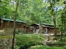 Cabin and main house are both included in property rental.