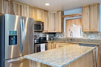 Stainless steel appliances, granite counter tops, under lighting cabinets will make cooking meals enjoyable in this new kitchen.